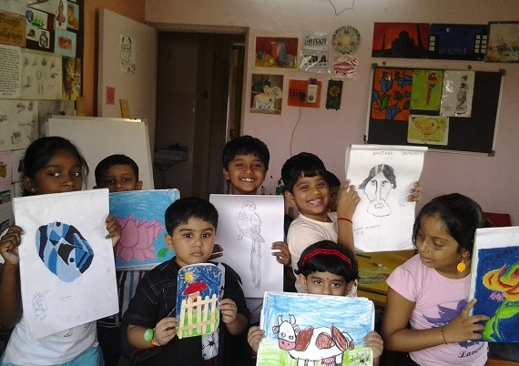 Group picture of kids with their artworks